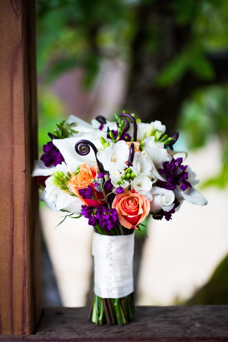 Kaitlin held a white, orange and purple bouquet filled with roses and calla lilies accented with fiddlehead fern and stock.