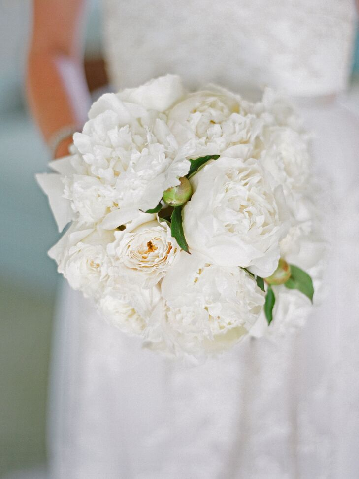 Margot carried a bouquet of ivory peonies arranged by Botonica.