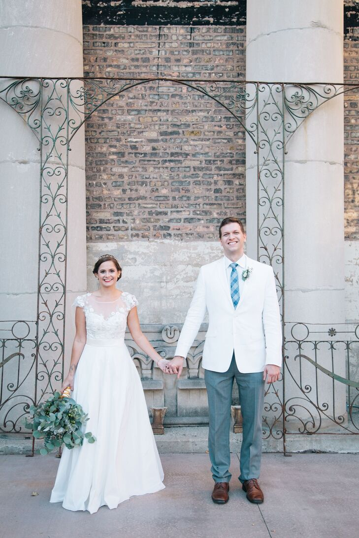 "Both the bride and groom wore white for their big day. ""Rob wearing white was a great reminder to guests that it's his day too,"" Sarah says. ""Plus, it took some attention off of me!"""