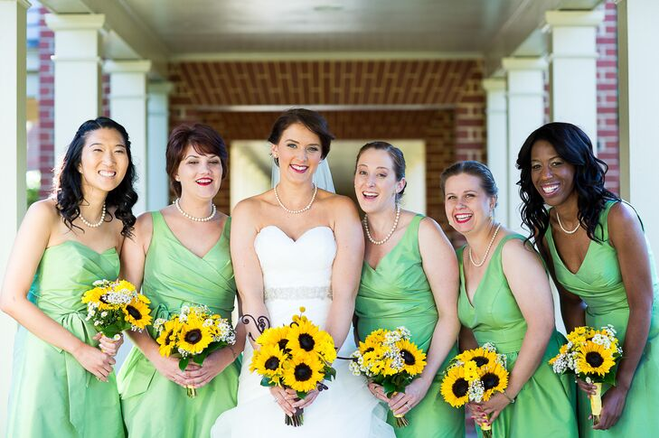"The bridesmaids wore ""appletini"" green dresses in different styles by Alfred Sung. They carried small bouquets of sunflowers and baby's breath."