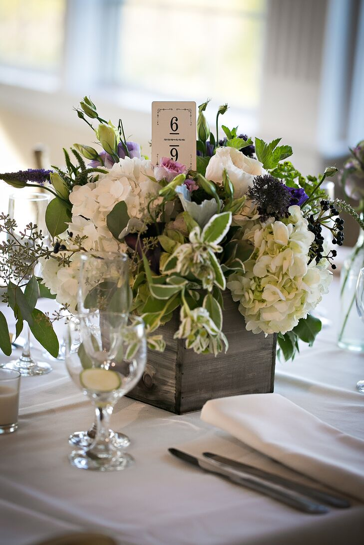 Ivory Hydrangea Centerpieces in Distressed Wooden Vases