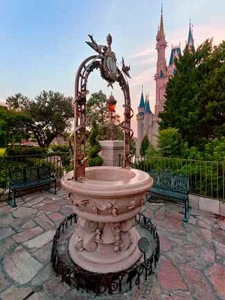 Romantic proposal idea in front of Cinderella's Wishing Well at Walt Disney World