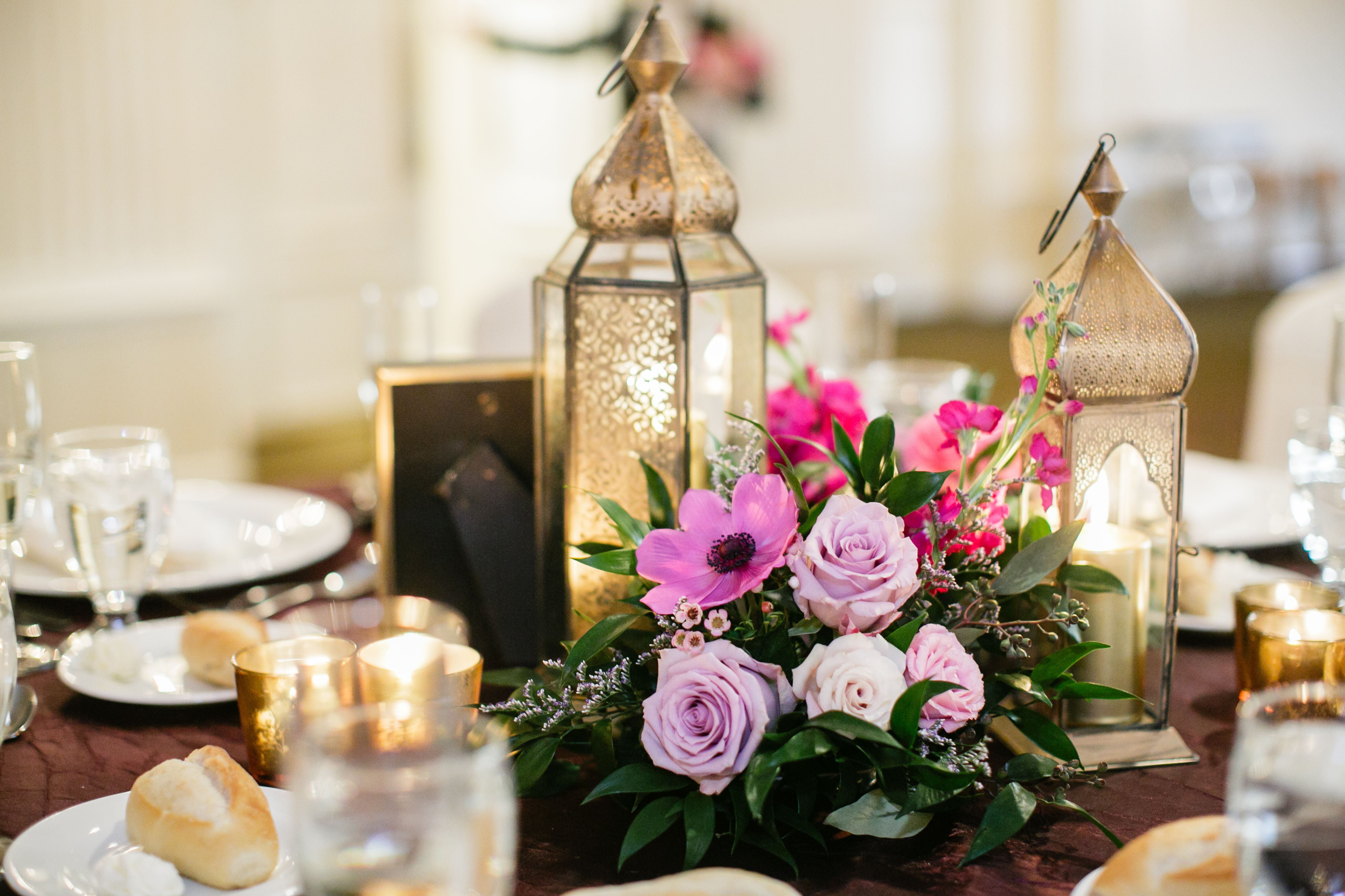Gold lantern and purple flower centerpieces