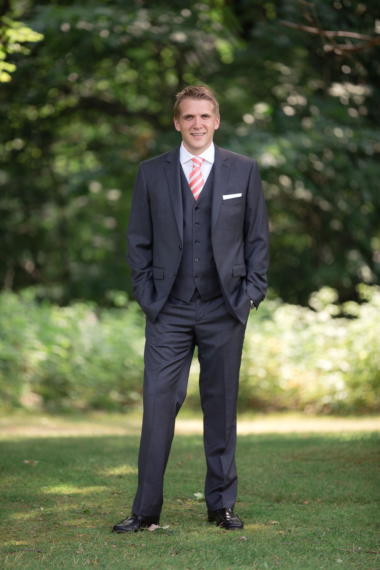 Dark Gray Groom Suit With White And Coral Tie