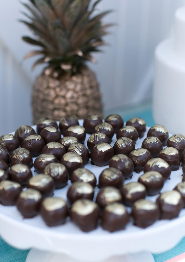 Chocolate truffles with gold accents