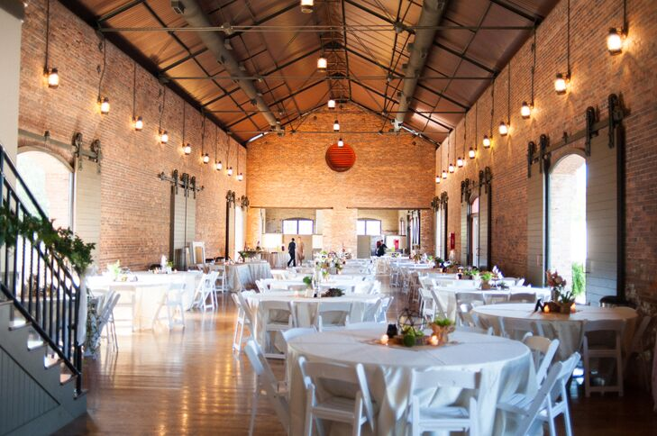 "The couple chose to host their reception at the Depot on Bradley Street in Carrolton, Georgia, because it embodied the elegant, rustic style they envisioned. ""The brick walls and large wooden doors of this old train station provided the perfect backdrop to celebrate our marriage,"" Emily says."