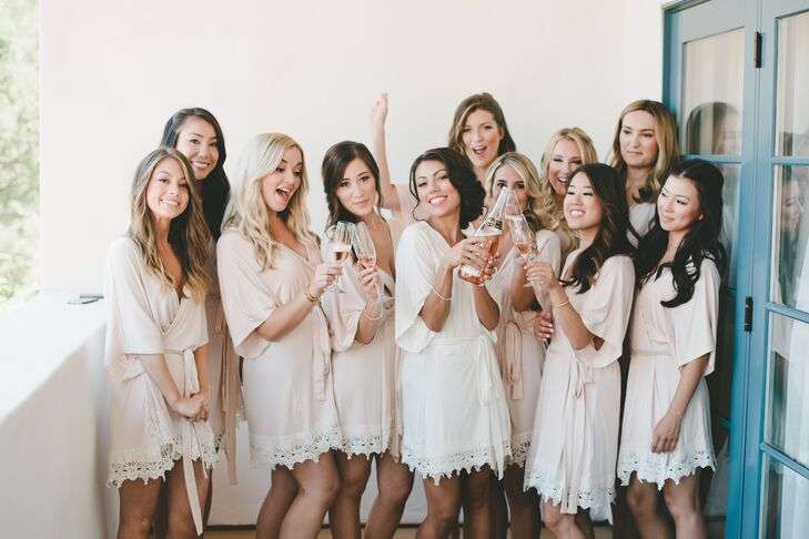Brittany and her bridesmaids wore matching blush pink robes from Pretty Plum Sugar while primping for the day.