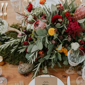 Rustic wedding centerpieces moss and lush fall floral centerpiece junglespirit