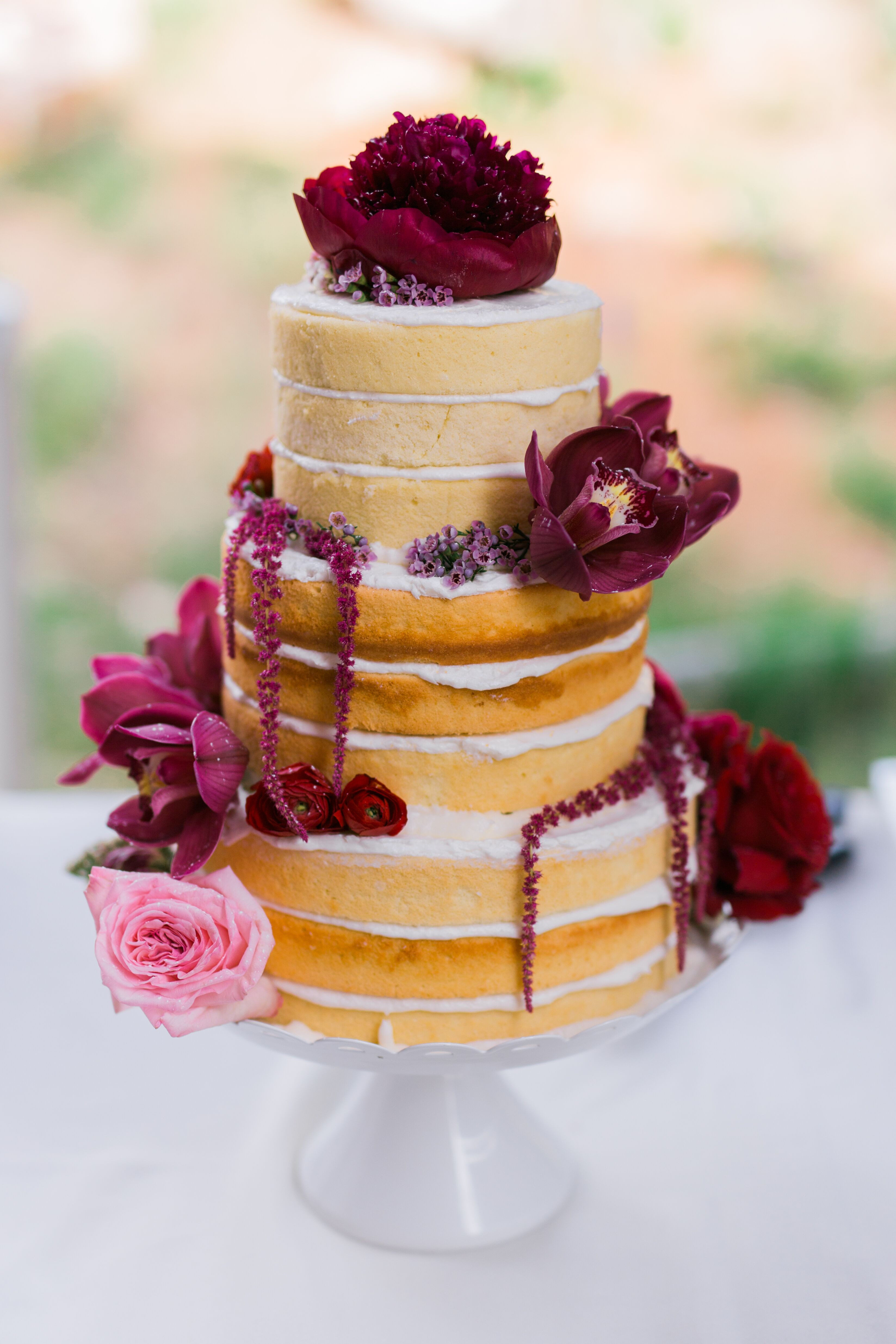 Homemade Naked Cake With Burgundy Flowers