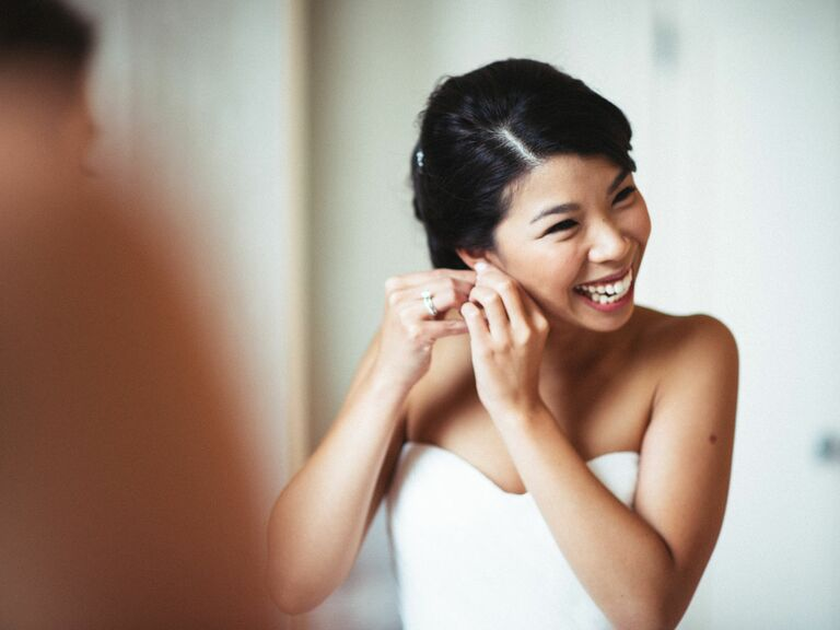 Bride putting getting ready in bridal suite before wedding