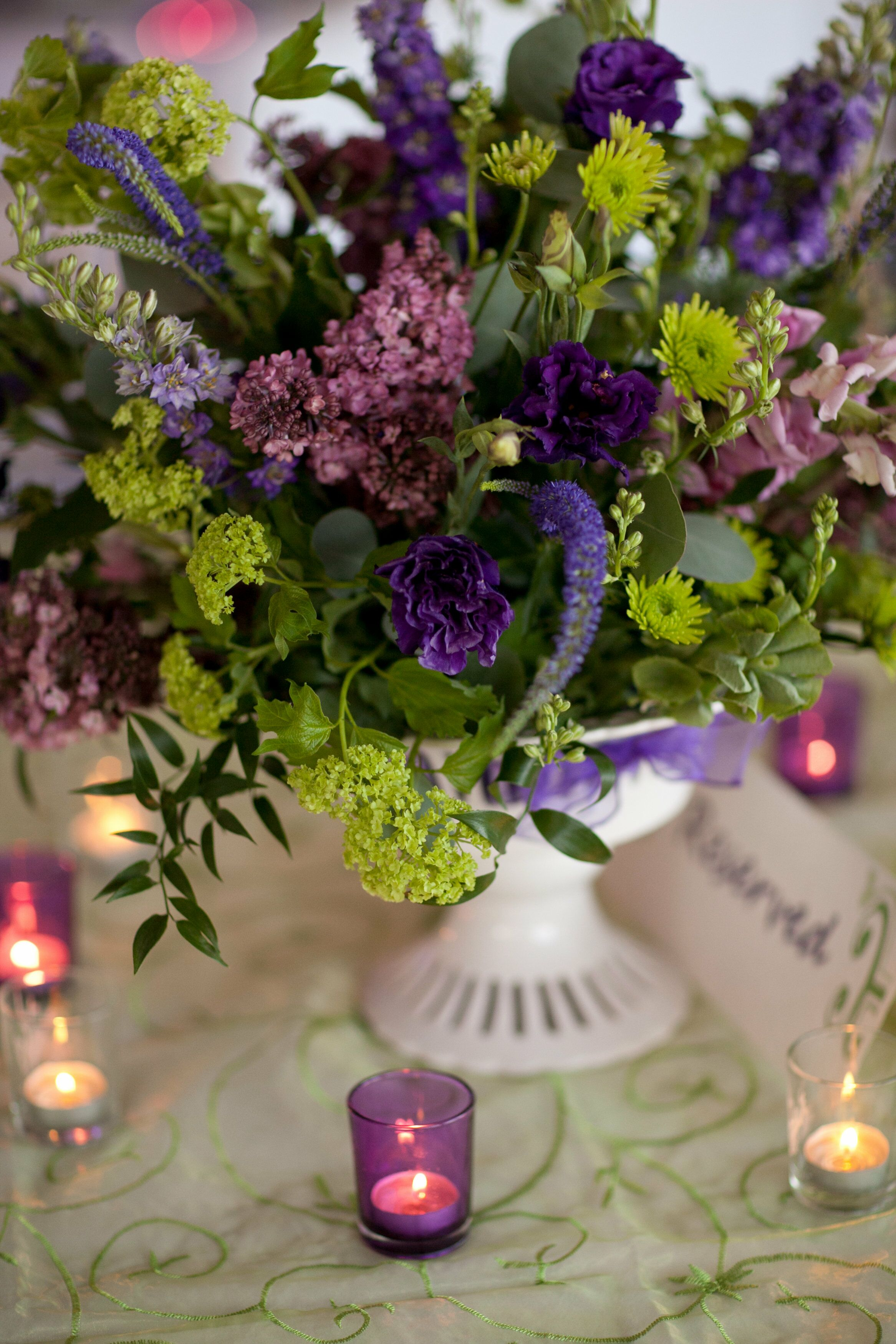 pedestal purple and green flower arrangement