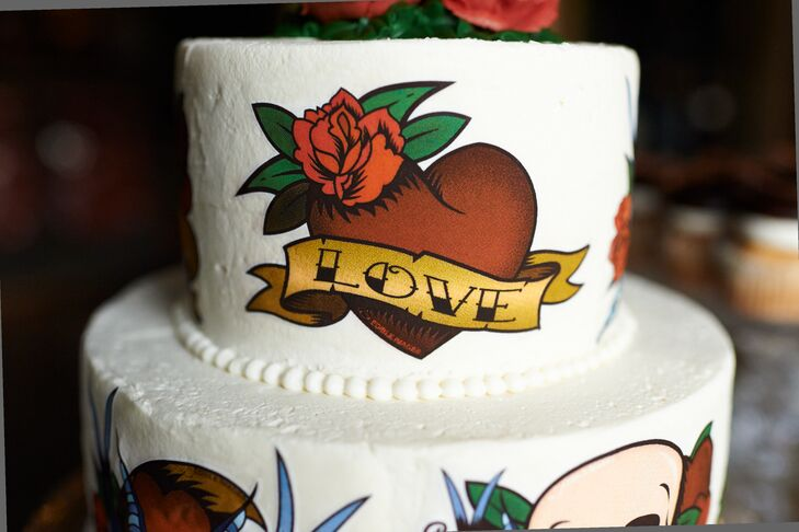 The couple served a small, two-tier wedding cake covered in flash art tattoos from Angel Food Bakery.