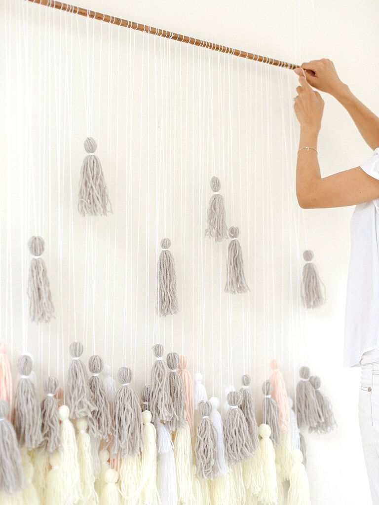 Cute DIY wedding decor idea, a tassel backdrop