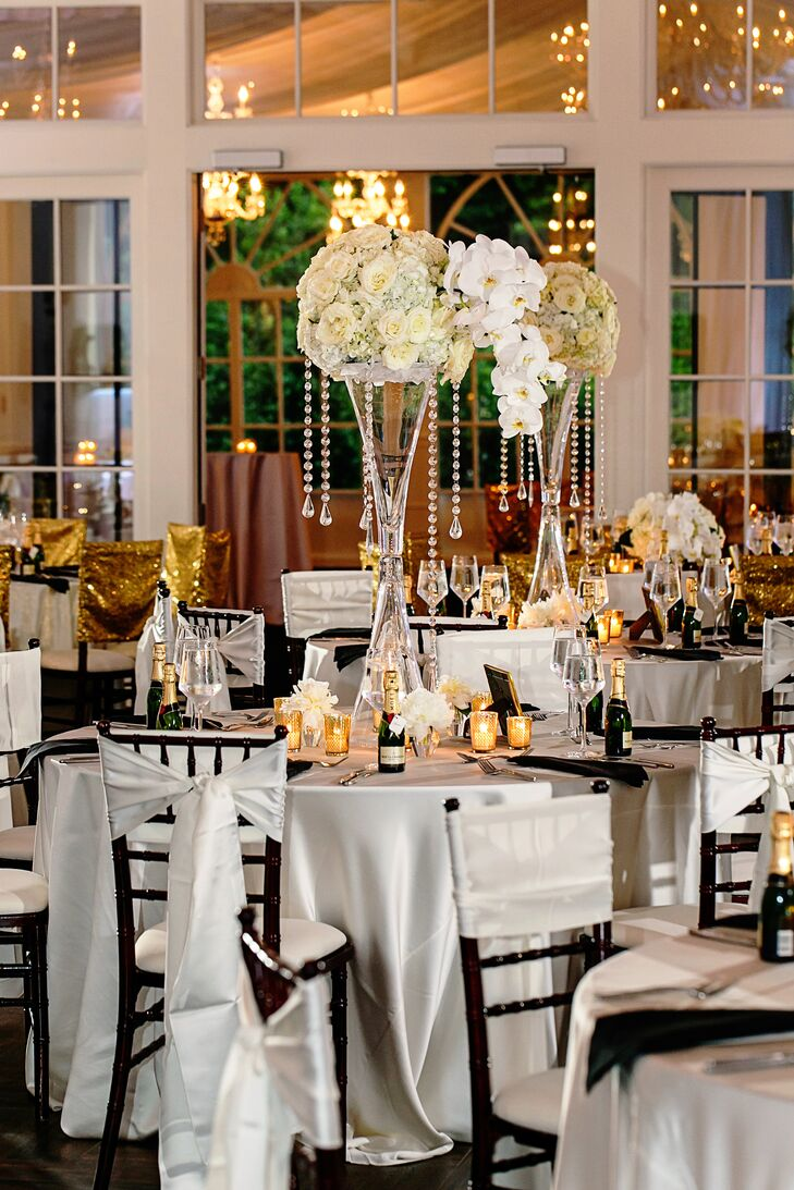 Tall hourglass white flower and crystal centerpieces