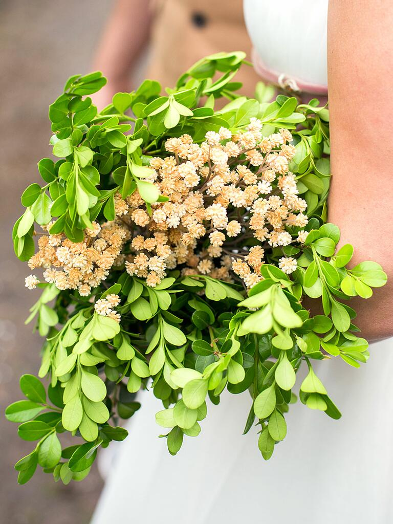 Unique wedding bouquet made from greenery and wildflowers
