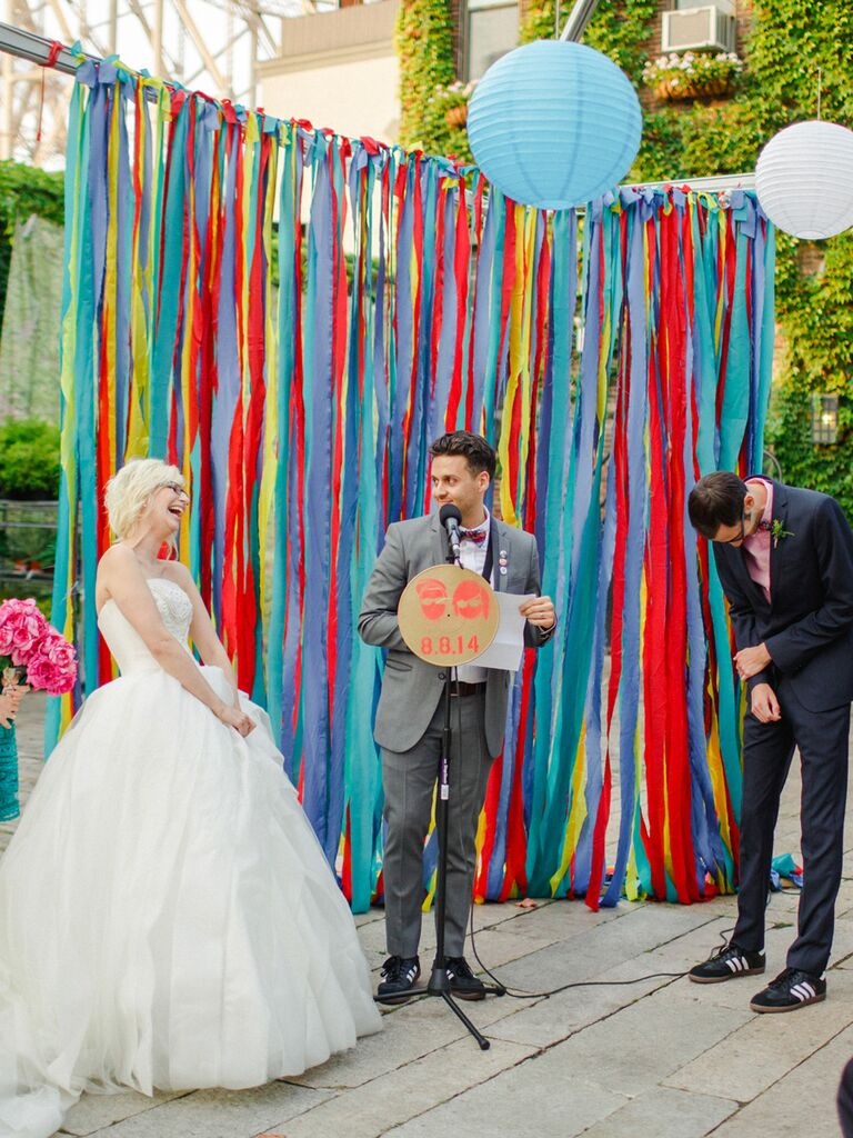 Colorful ribbon backdrop at an outdoor ceremony