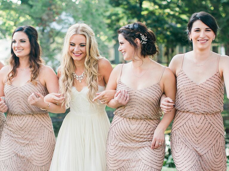 bride and three bridesmaids in sequined dresses