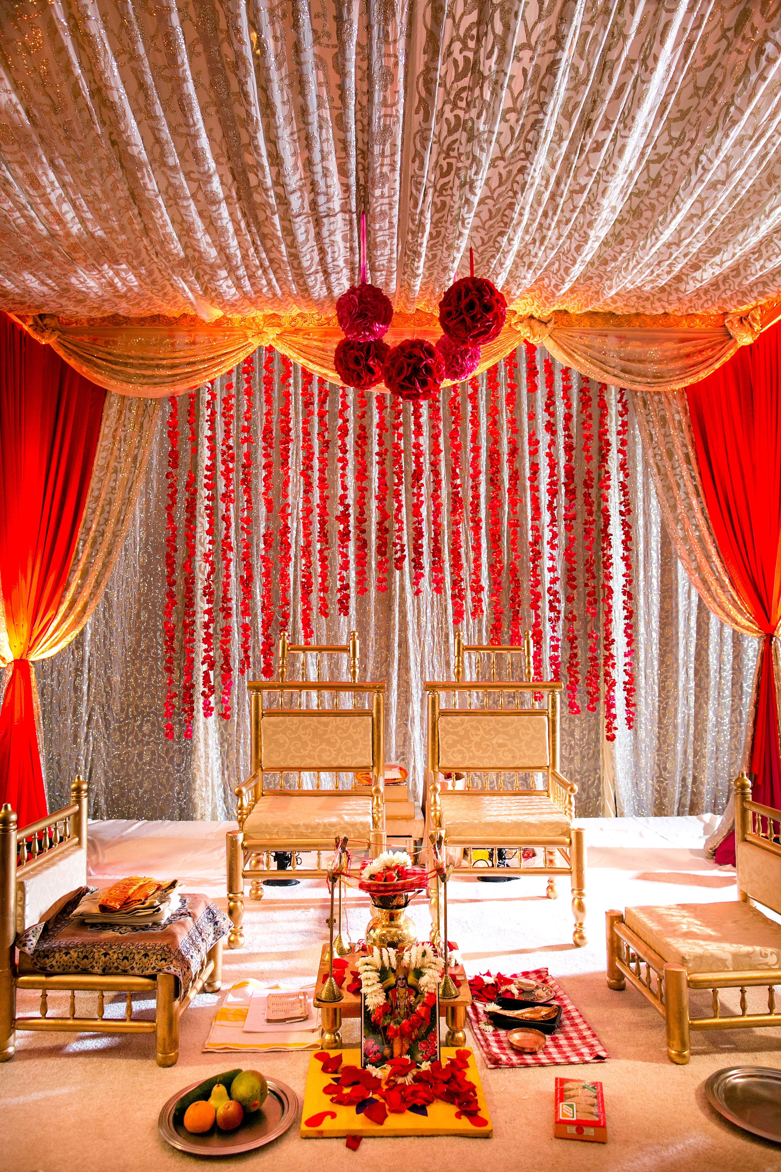 an ornate red and gold traditional indian mandap. Black Bedroom Furniture Sets. Home Design Ideas
