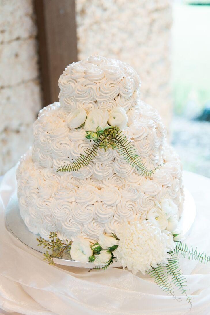 White Tiered Wedding Cake With Swirl Detail