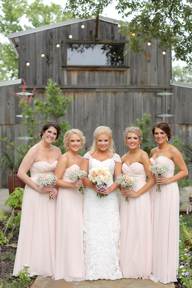 Long strapless blush chiffon dresses for the bridesmaids couldn't have been a better fit for Rachel and Jeremy's theme of lighthearted romance. They each carried a bundle of baby's breath with a blush spray rose or two to tie a touch of Southern style.