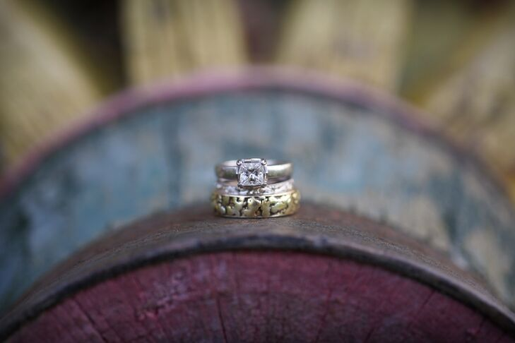 Brad proposed with a princess-cut diamond engagement ring in a bold silver setting. They loved the classic, chic look of it. Brad chose a textured band for himself.