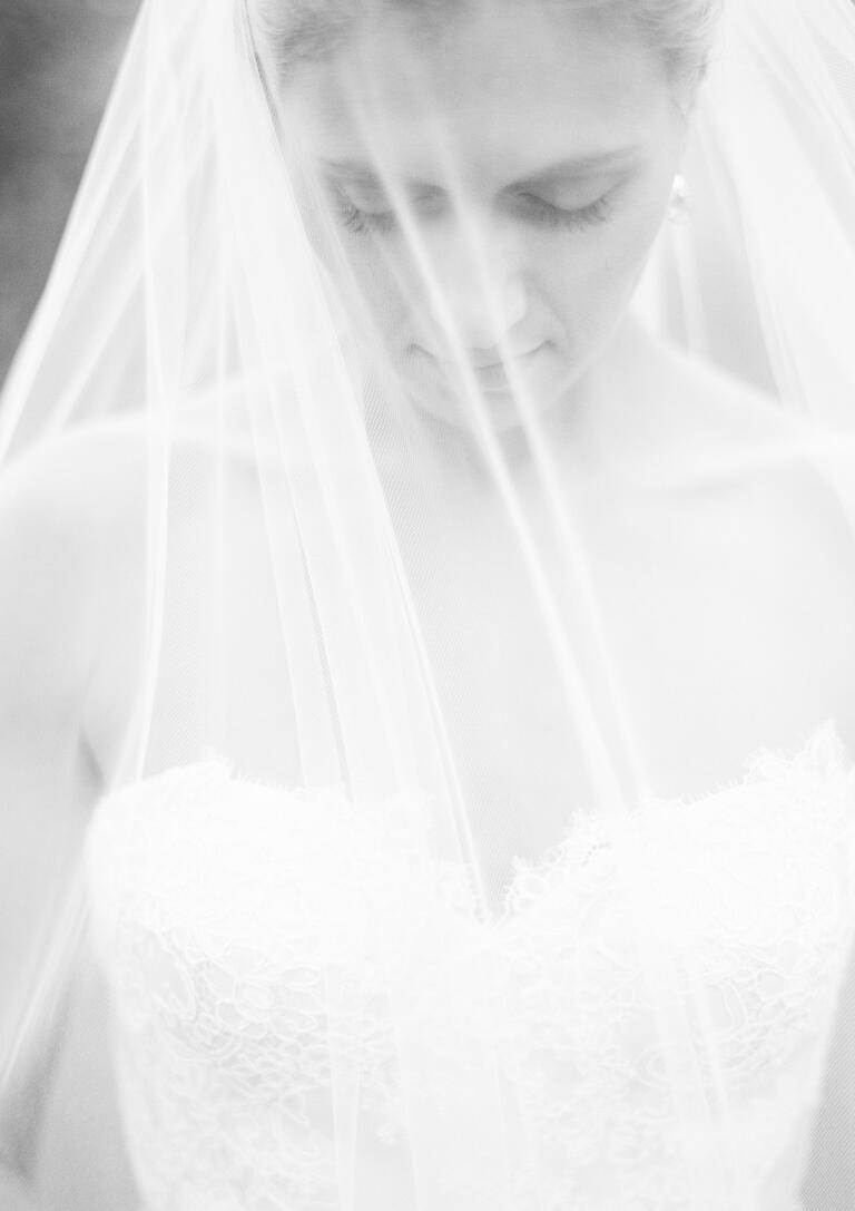 Black and white photo of bride wearing veil