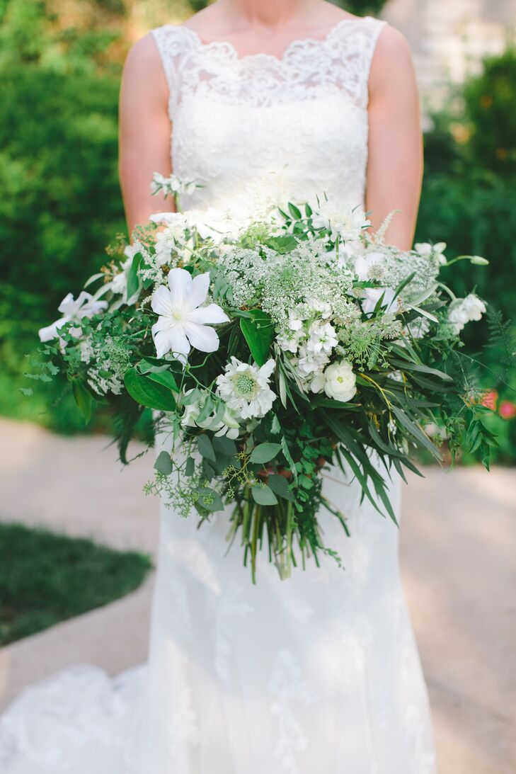 """I wanted something organic that looked like it had just been picked from a garden,"" says Kaleigh of her textured, untamed bouquet. The stunning arrangement was overflowing with football mums, scabiosas, stock, clematis, astransias, Queen Anne's lace, astilbes, spray roses and an assortment of greenery like eucalyptus, maidenhair ferns, smilax and jasmine vine.rn"