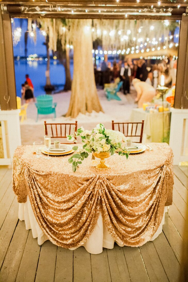 A green and gold wedding at paradise cove orlando in for Golden wedding table decorations