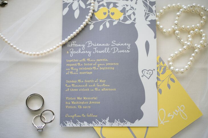 The gray, white and yellow invitation suite featured silhouettes of a tree carved with their initials and two love birds.