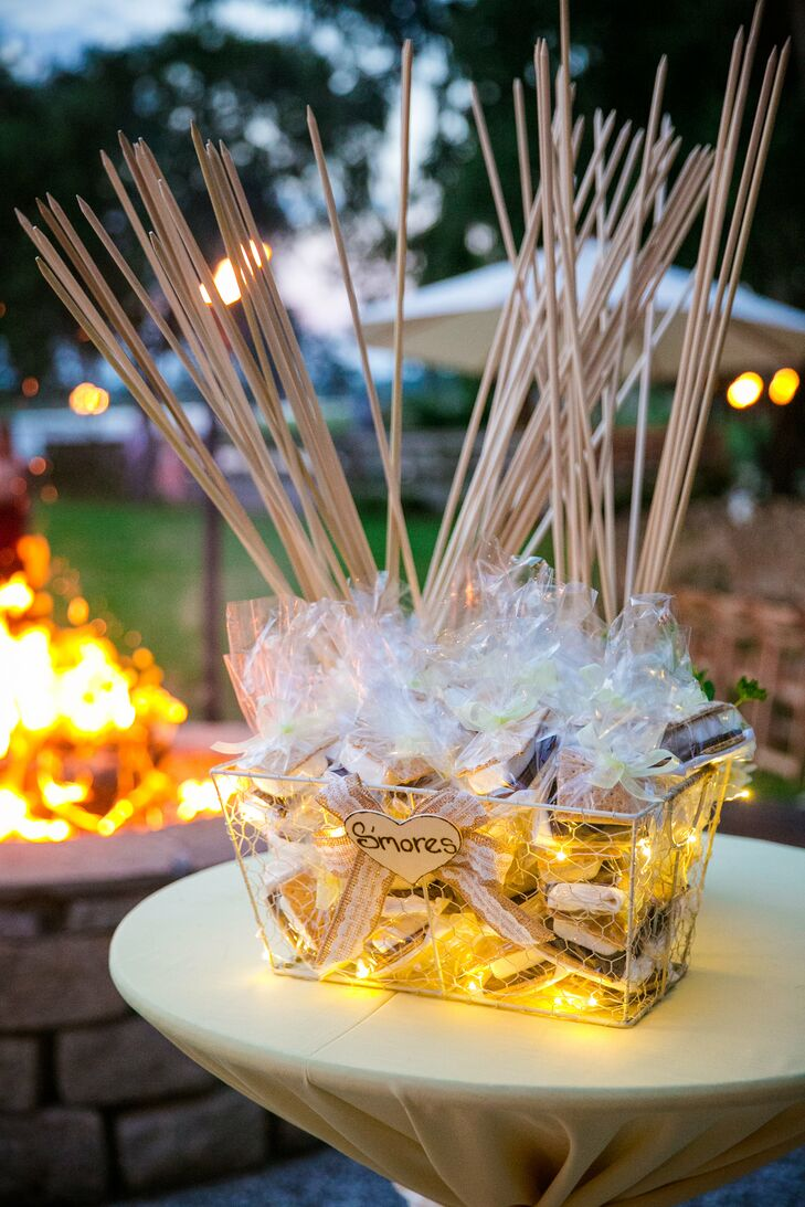 S'mores kits were placed in a basket decorated with tiny lights by the outdoor fire pit for guests to enjoy during the reception.