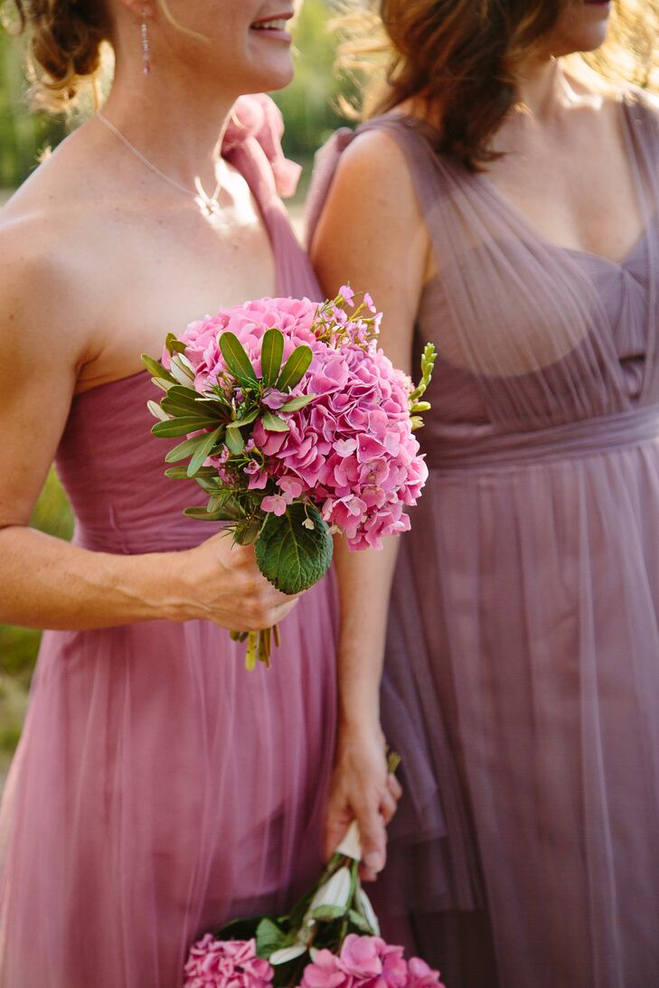 Since Patty and her mother's favorite flowers are hydrangeas, Patty knew she wanted them throughout the wedding. The bridesmaids carried round bouquets of the pink flowers, which perfectly matched the different shades of purple bridesmaid dresses from Nordstrom.
