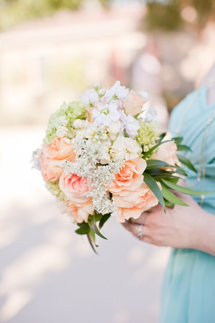 The bridesmaids carried soft, simple bouquets from florist Newberry Brothers. The flowers perfectly matched the pastel color palette and added a little romance to whimsical 'Alice in Wonderland' theme. The gorgeous arrangements included roses, Queen Anne's lace, sweet peas and leaves.