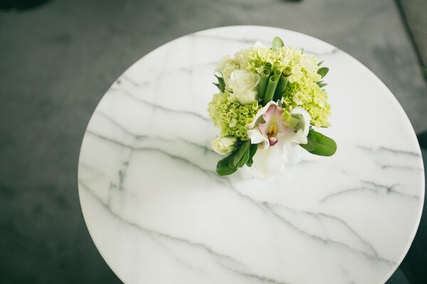 White orchid centerpiece in geometric vase
