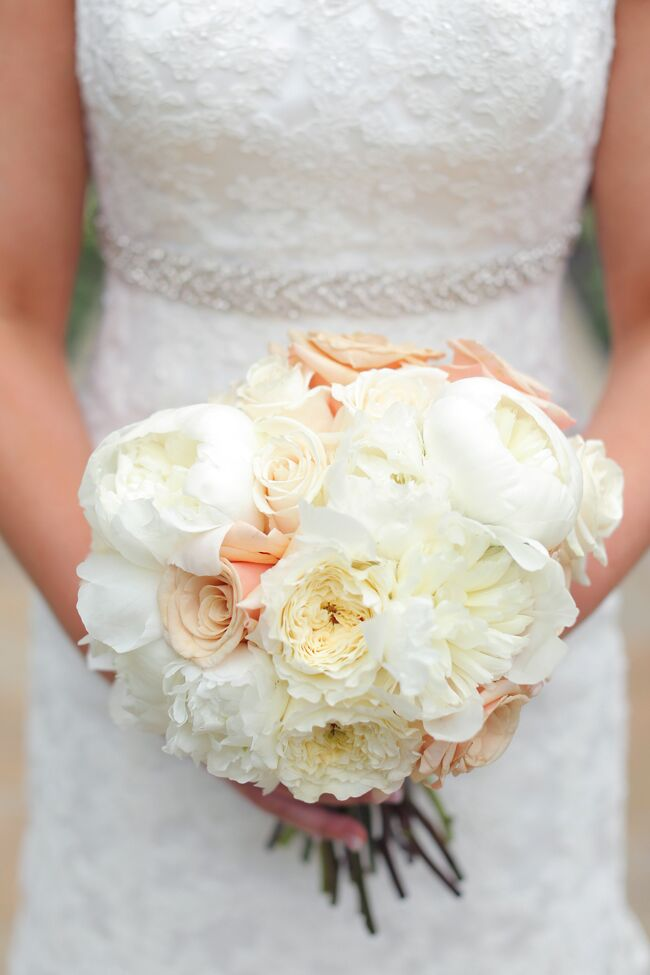 Nothing says romance like a bundle of peonies, garden roses and spray roses. Rachel's ivory and blush bouquet spoke to her romantic theme and was full of the soft colors she incorporated throughout her wedding.