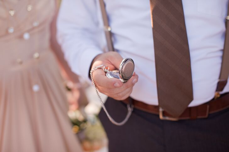 The groom and groomsmen each carried vintage silver pocket watches with their initials engraved onto the front. The White Rabbit-inspired detail was perfect for the wedding's 'Alice in Wonderland' theme.