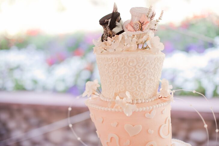 Miranda and Lance enjoyed an asymmetrical wedding cake that was made by Miranda's cousin. The cake combined the pastel color palette and 'Alice in Wonderland' influences, such as the hearts on the second tier and the bride and groom Mad Hatter cake topper.