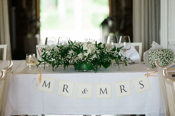 Baby's Breath and White Rose and Hydrangea Centerpieces