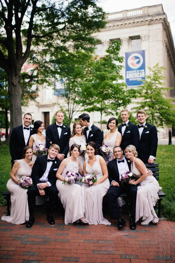 The bridesmaids dressed in floor length, taupe dresses by Jim Hjelm while the groomsmen wore classic black tuxedos with bow ties to the spring wedding.