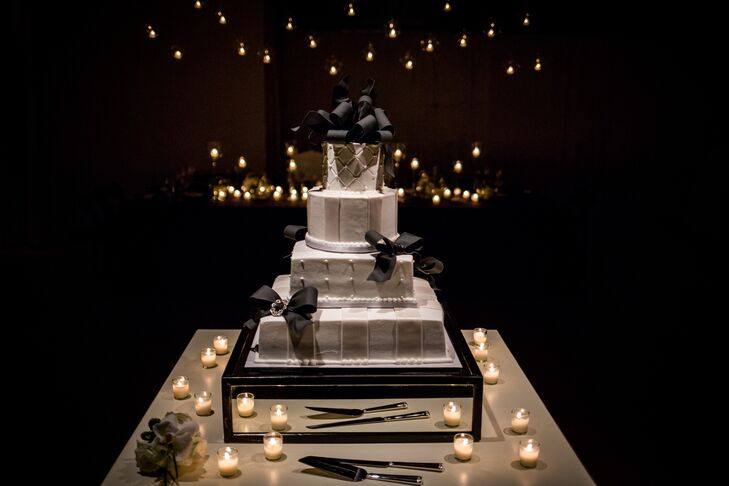 For dessert, the couple enjoyed a four-tier fondant wedding cake with both square and round tiers.