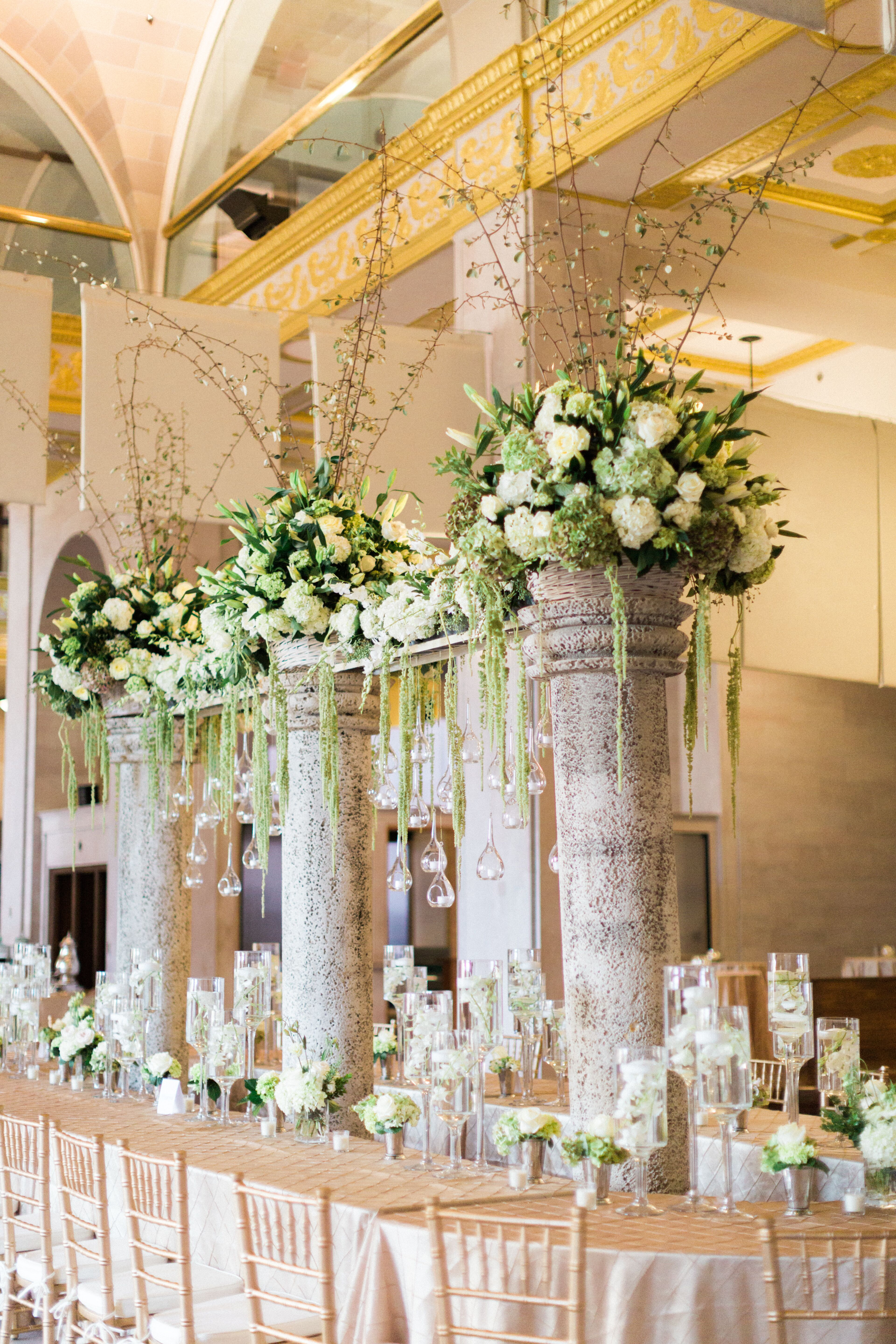 tall column centerpieces with hanging glass globes