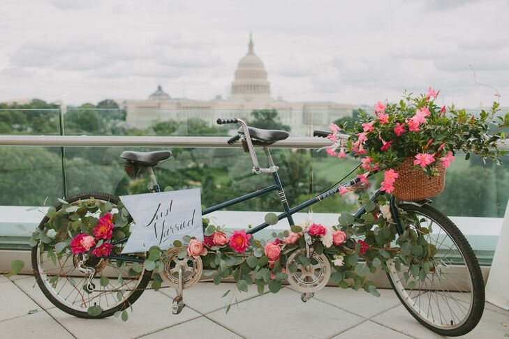 "Mark proposed to Brittany during a bicycling date night, so bicycles became a theme throughout the wedding. ""We picked up Capital Bikeshare bikes and cycled down past the Capitol and along the Mall,"" Brittany says. ""We stopped on a bench near the Lincoln Memorial and Mark asked me to marry him."""