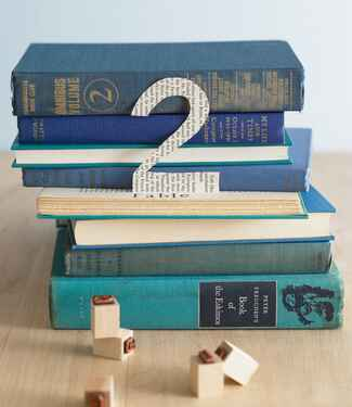 DIY stack of vintage books table number and centerpiece
