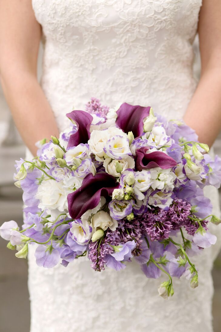 Sara's bridal bouquet was full of purple and white flowers including dark, textured calla lilies, which made appearances in all of the day's floral arrangements.