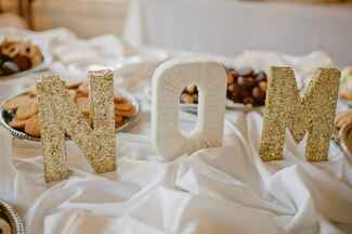 Gold glitter and yarn wrapped cardboard initials