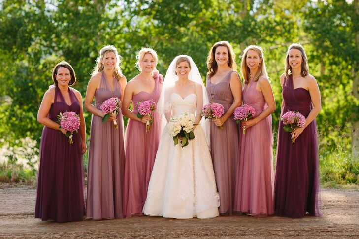The bridesmaids all wore different shades and styles of purple for the refined rustic wedding. Patty loved that each could customize her Jenny Yoo dress to suit her style and personality while still matching each other.