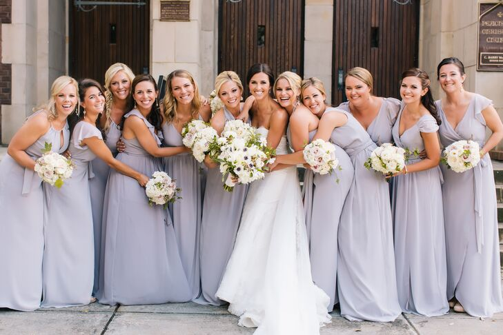 The bridal party wore lavender dresses of different styles from the Ceremony by Joanna August line at Bella Bridesmaids. She chose the color and they were able to pick the one that suited them best.