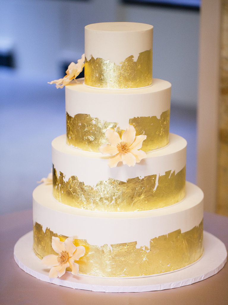 White wedding cake with gold foil decorations