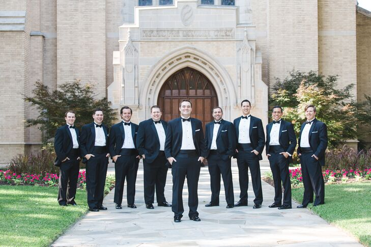 Matt and his groomsmen went cool and classic in black-and-white tuxes, complete with black bow ties and cummerbunds.