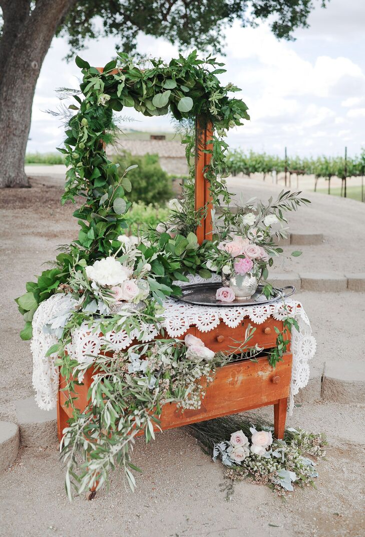 Vintage touches, like a reclaimed vanity draped in lush garlands and lacy linens, were incorporated throughout.