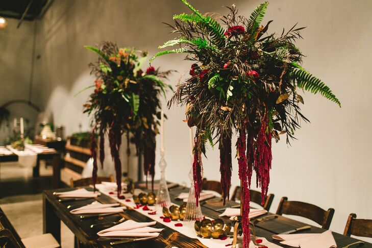 The high centerpieces had a unique rustic vibe with lush greenery and hanging red amaranthus.